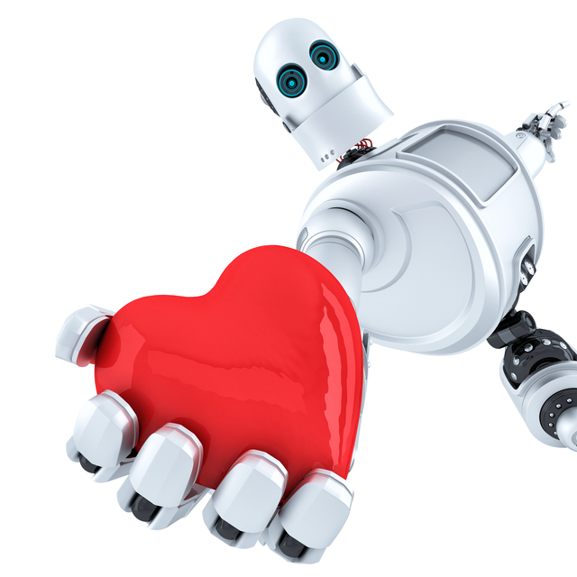 Robot holds heart in his hand. Isolated. Contains clipping path