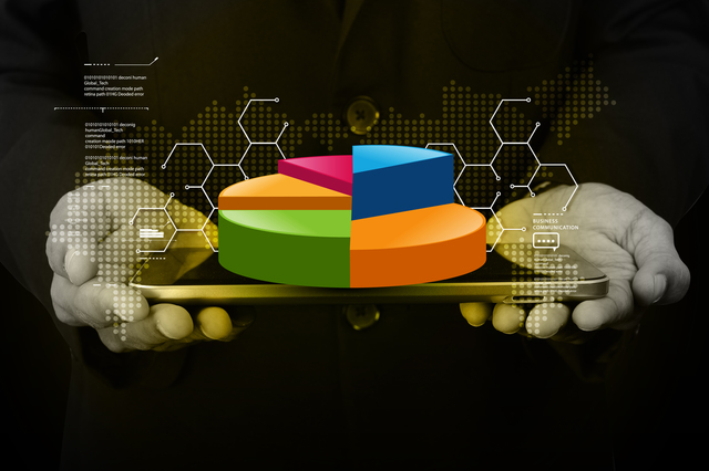 Business man showing pie chart with tablet computer in color background
