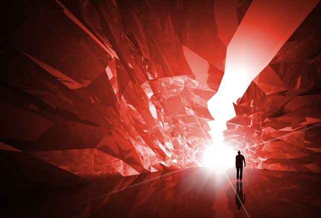Man walks through the fantasy red crystal corridor with bright glowing end