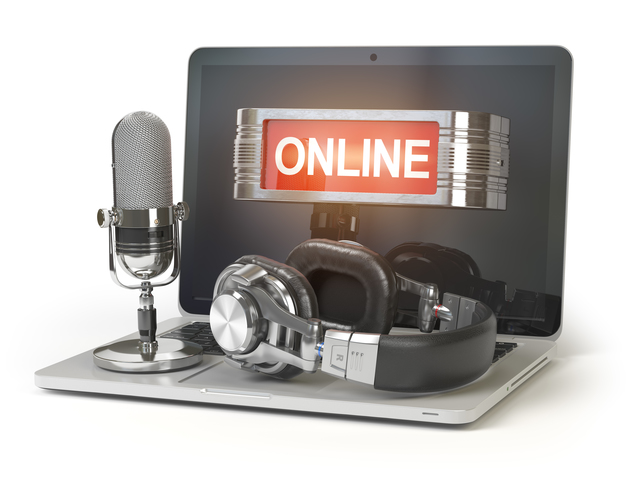 Online support concept. Laptop with microphone, headphones and lightbox with text online isolated on white background.